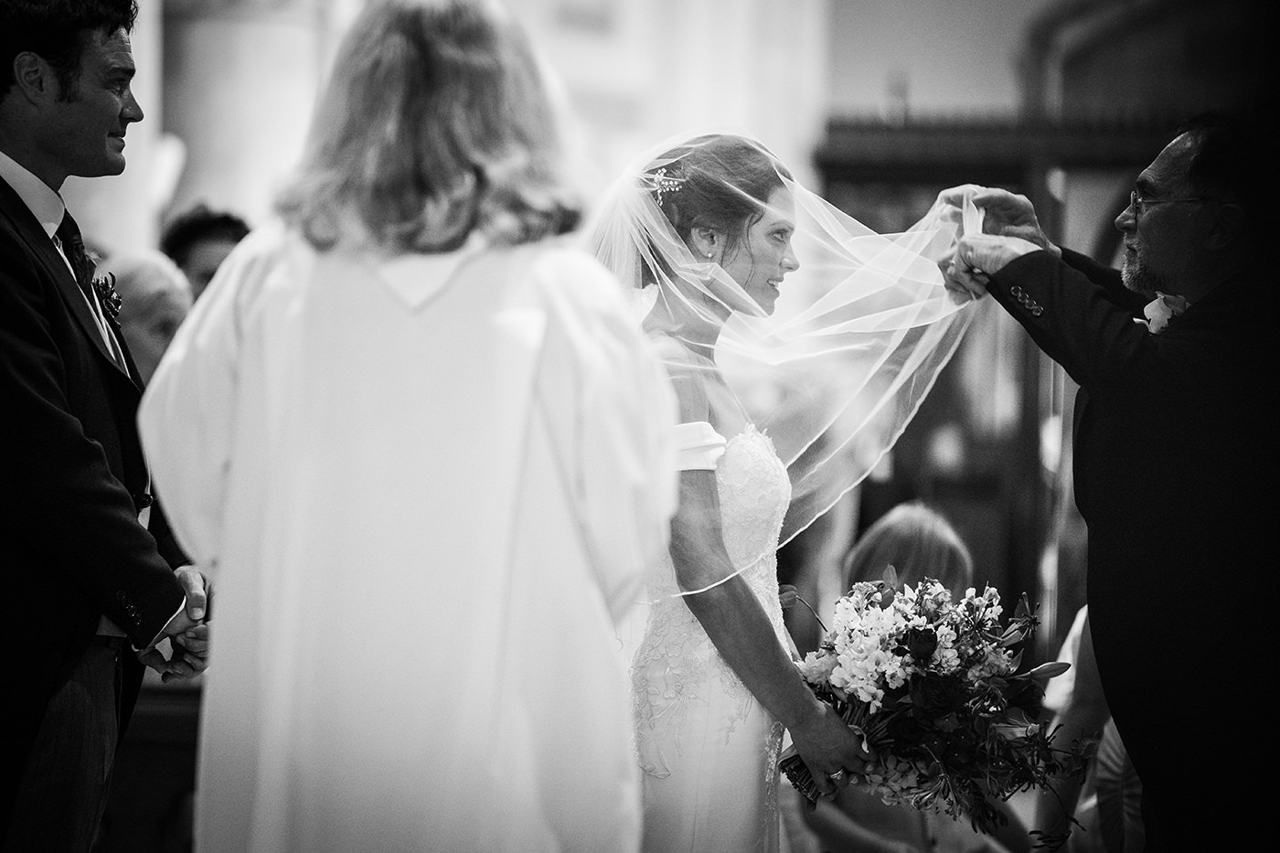 Father lifting Brides Veil