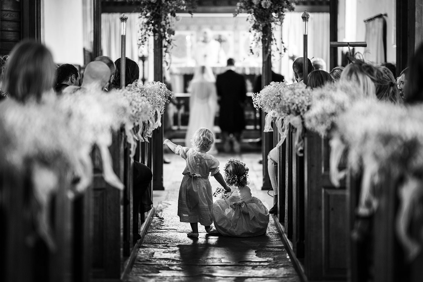 Flower Girls in Church Reportage Photographer