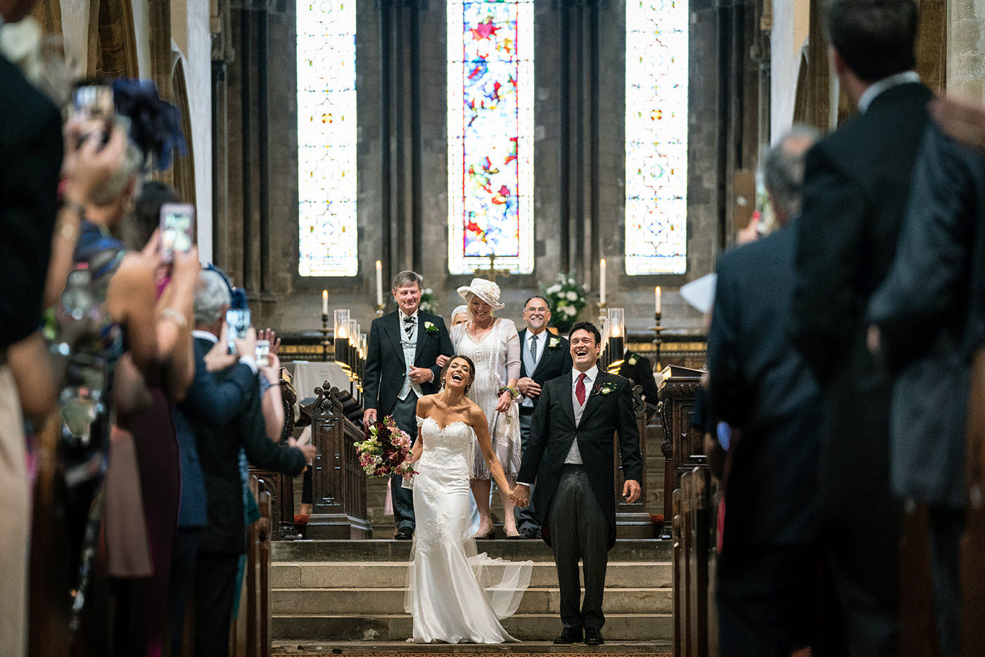 Newlyweds Walking Down the Aisle at Wimborn Minster