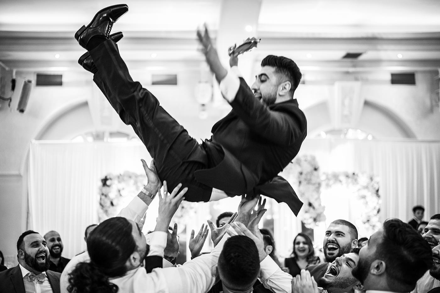 Groom being thrown in the air at The Decorium London