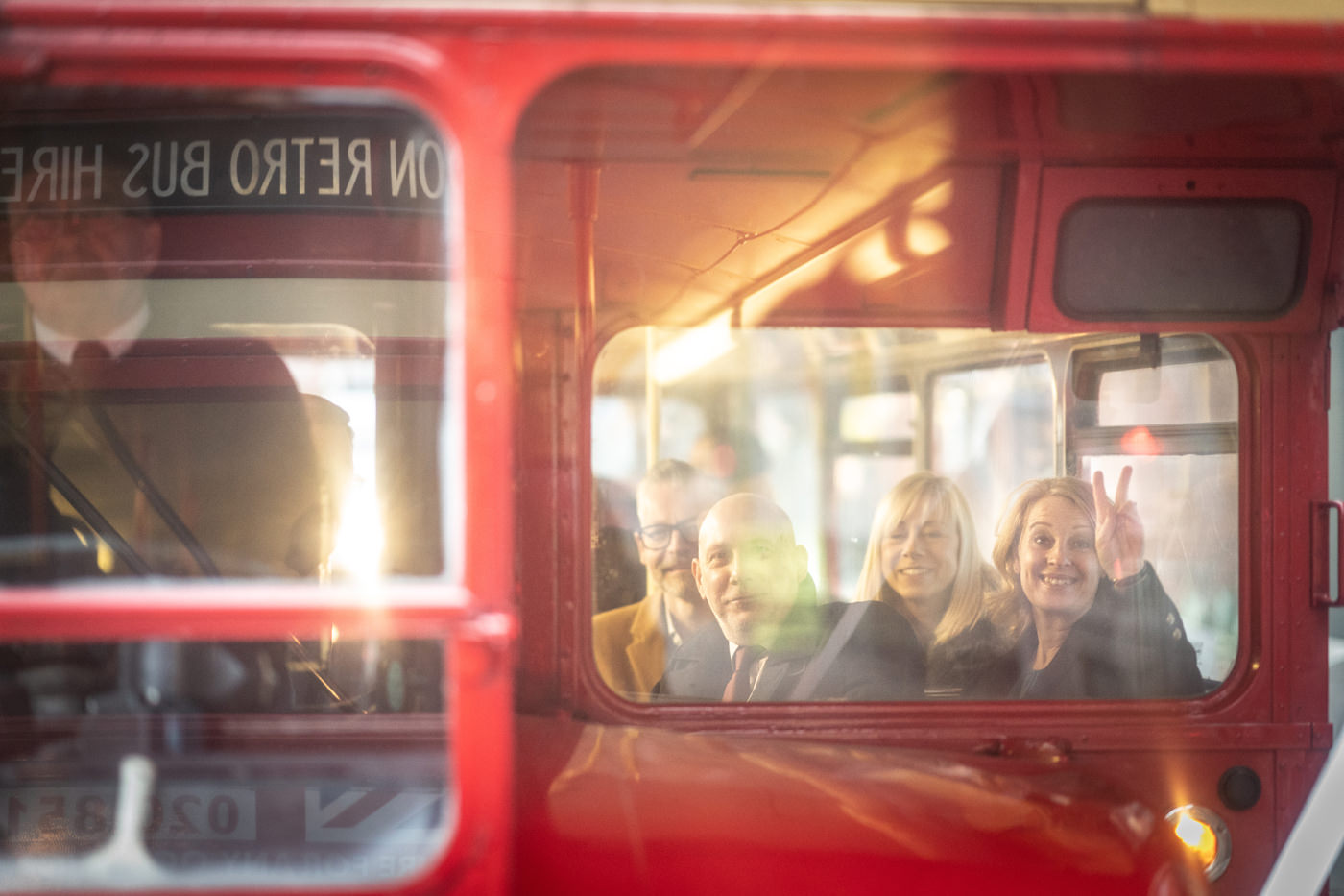 Wedding Guest does a V sign from a Routemaster Bus