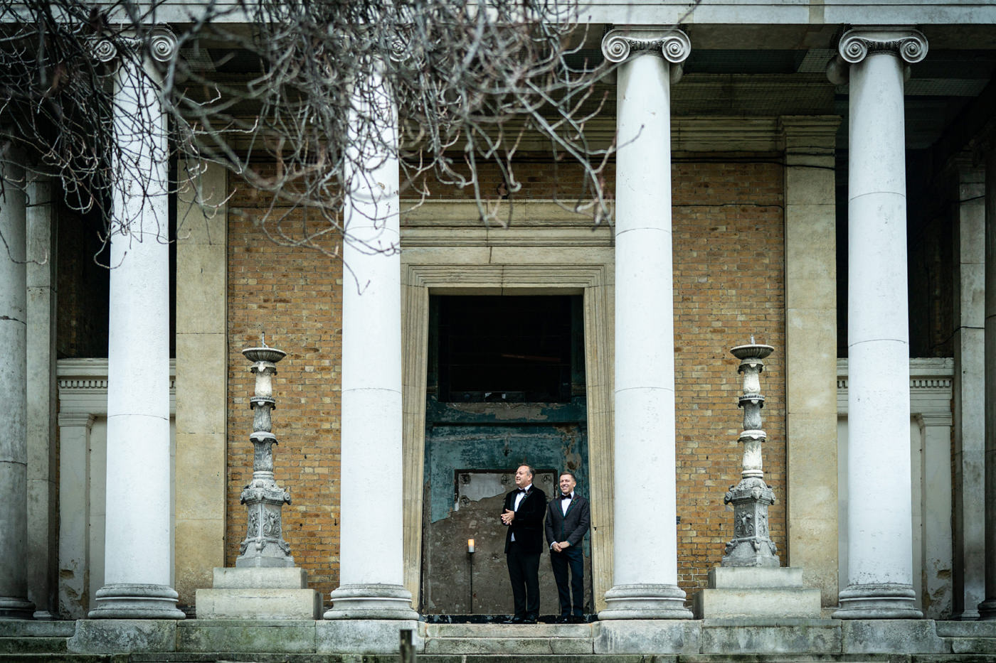 Two Grooms prepare to greet their wedding guests at The Asylum Chapel Peckham