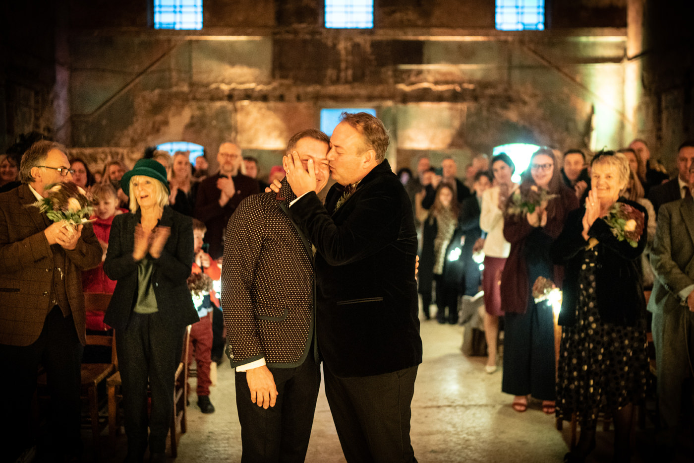 Two grooms kiss at The Asylum Chapel London