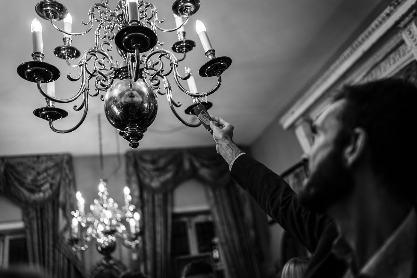 Wedding Guest checks out the price on a chandelier at Brunswick House