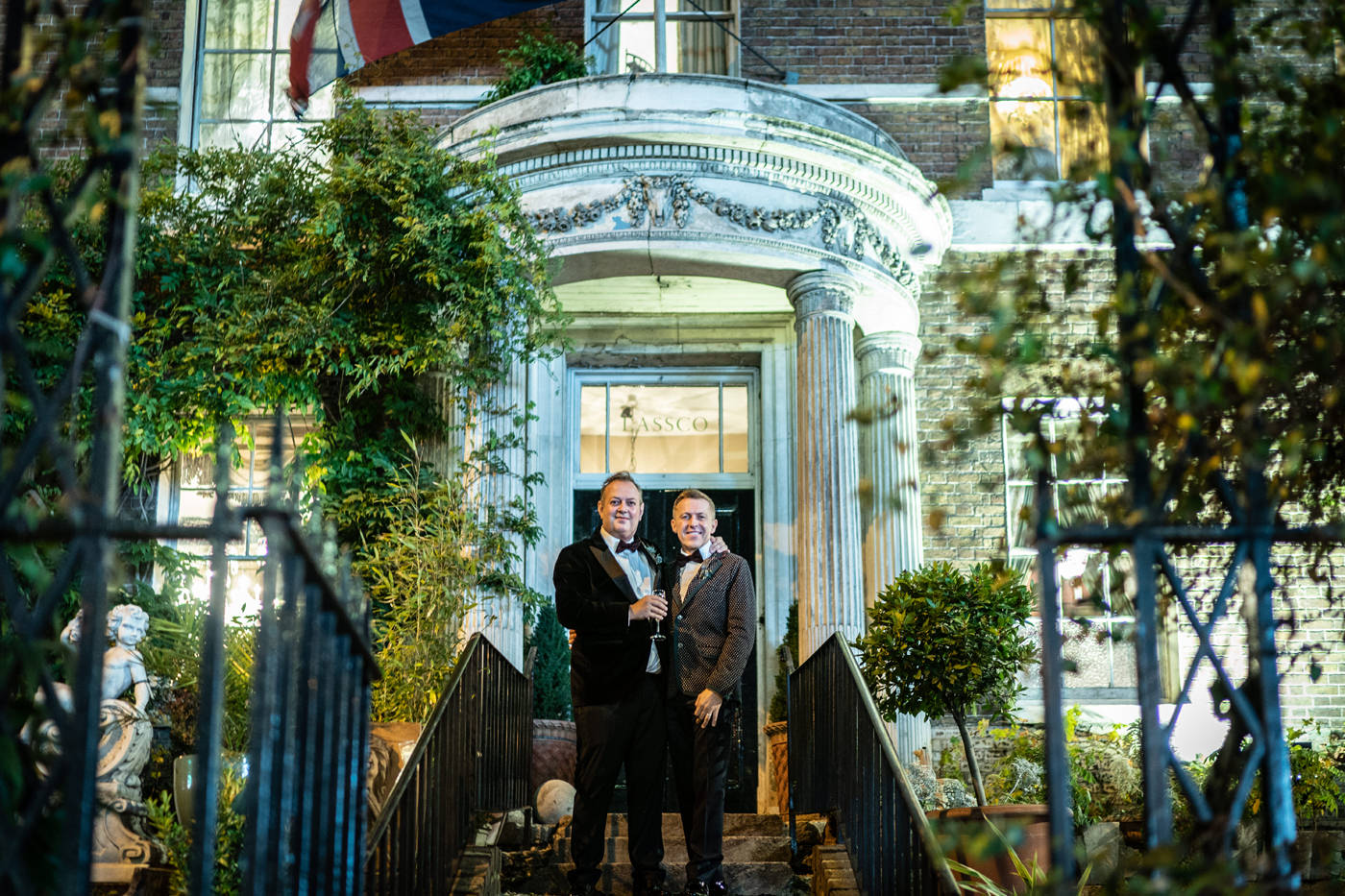 Gay newlyweds pose outside Brunswick House in London