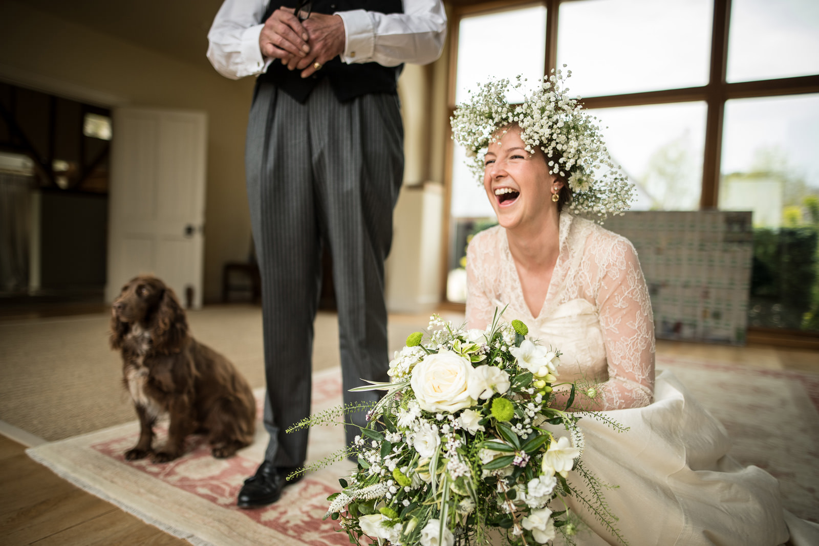 Laughing Bride with flowers and dog