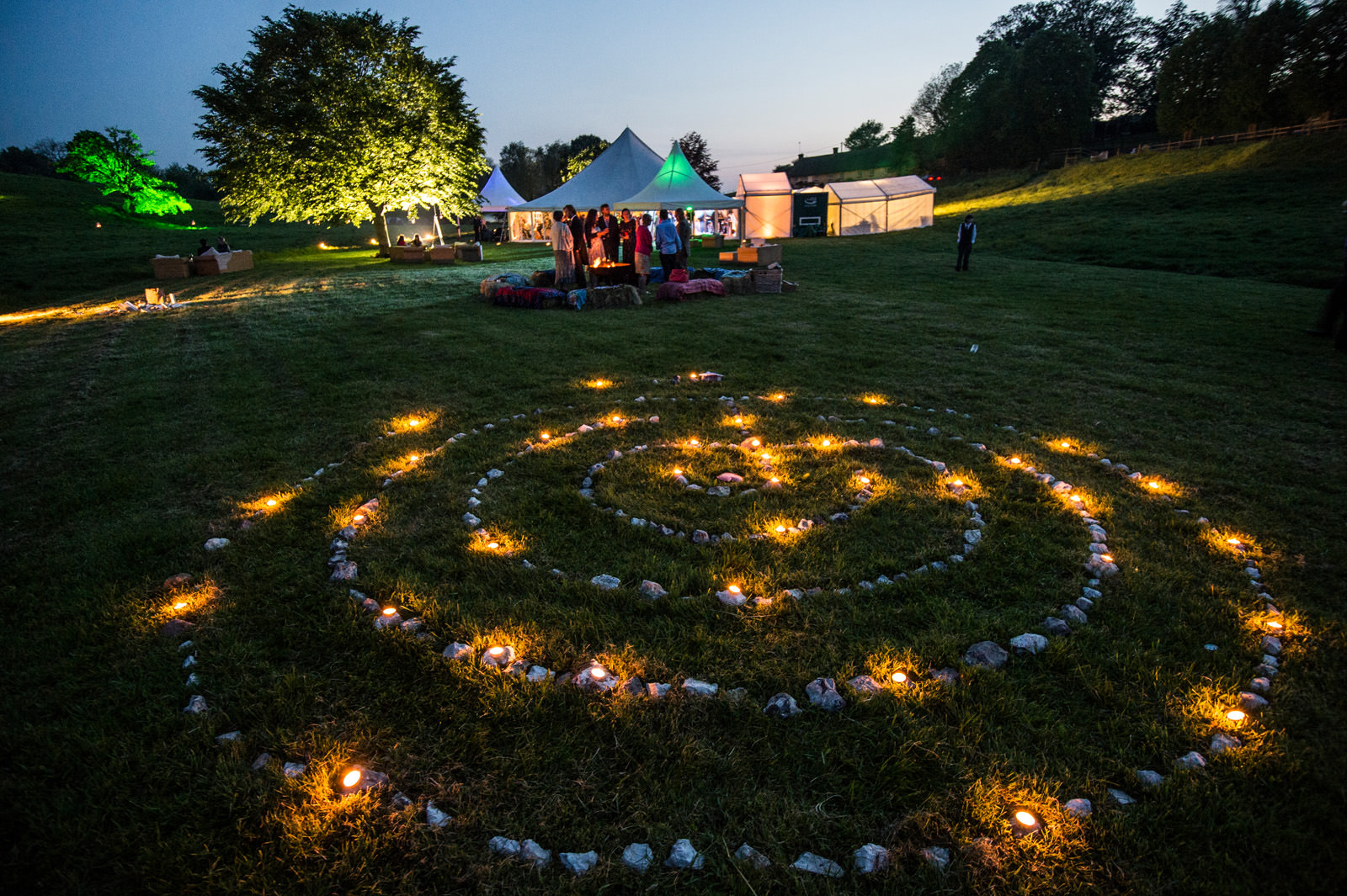 Stone and candle maze near wedding marquee