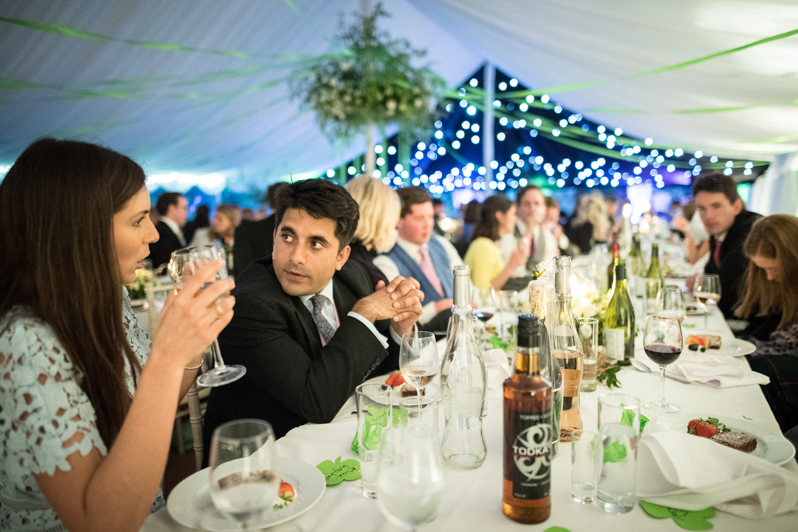 Guests enjoy the wedding breakfast in a Dorset Marquee