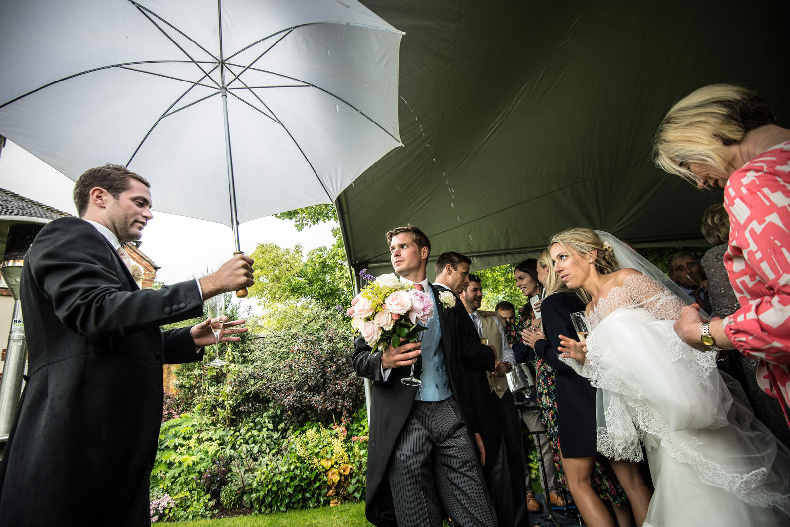 Wedding guests shelter in their Dorset Wedding Marquee