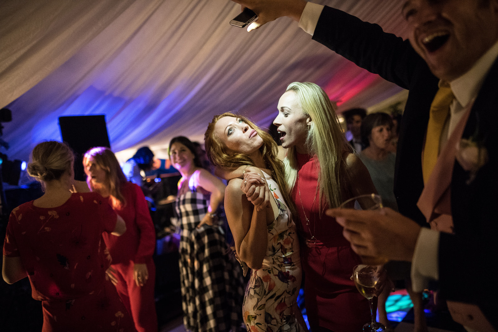 Wedding guests dancing in a marquee