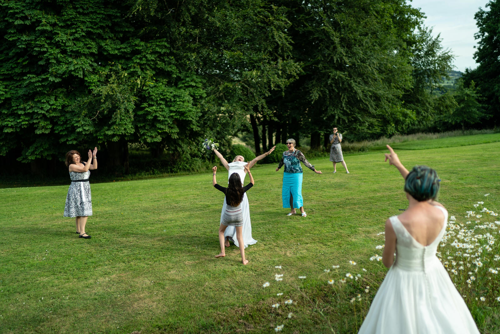 Throwing the bouquet the croquet lawn