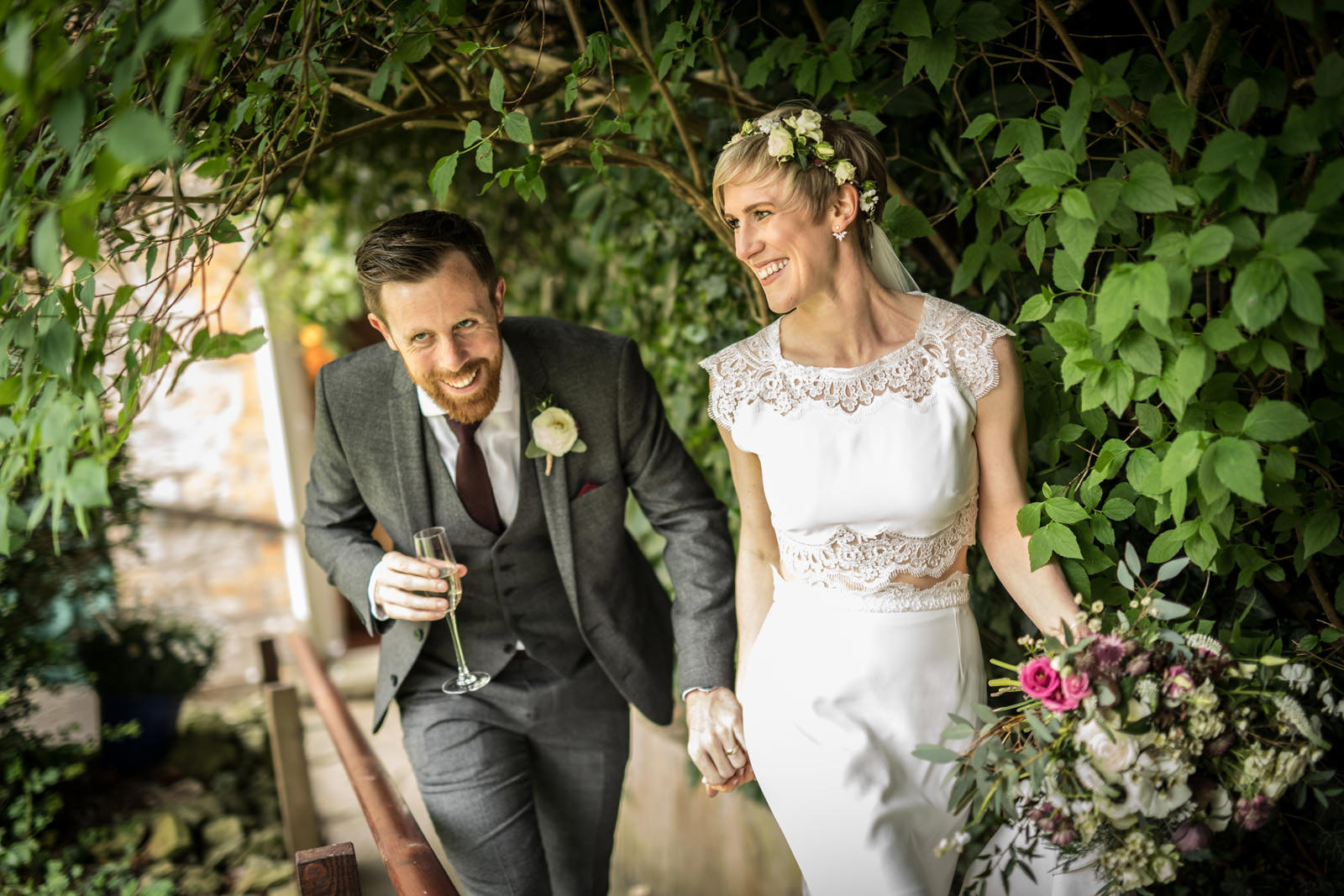 Newlyweds arrive to their wedding reception in Granny's garden
