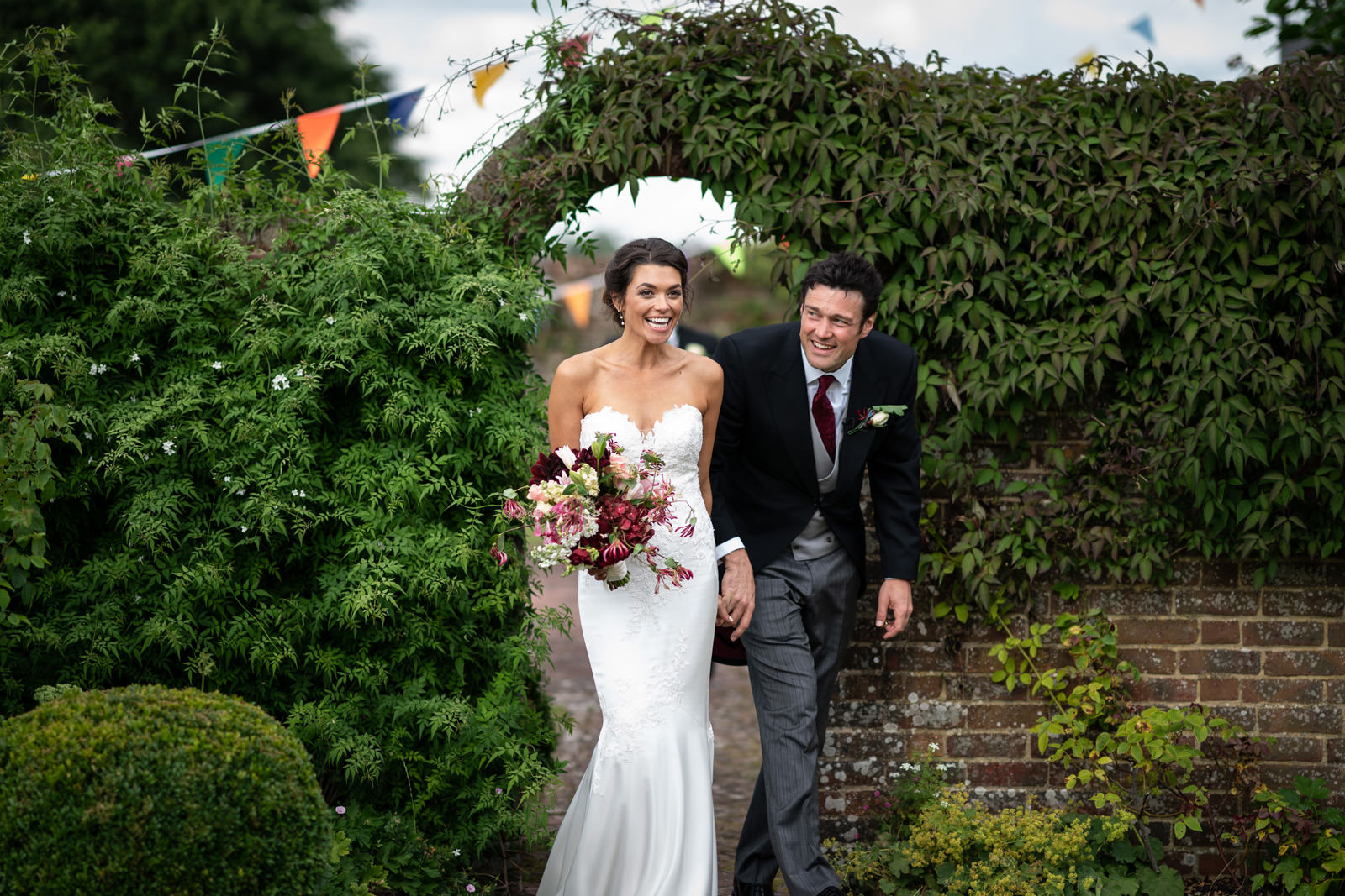Couple arrive at their wedding with bunting
