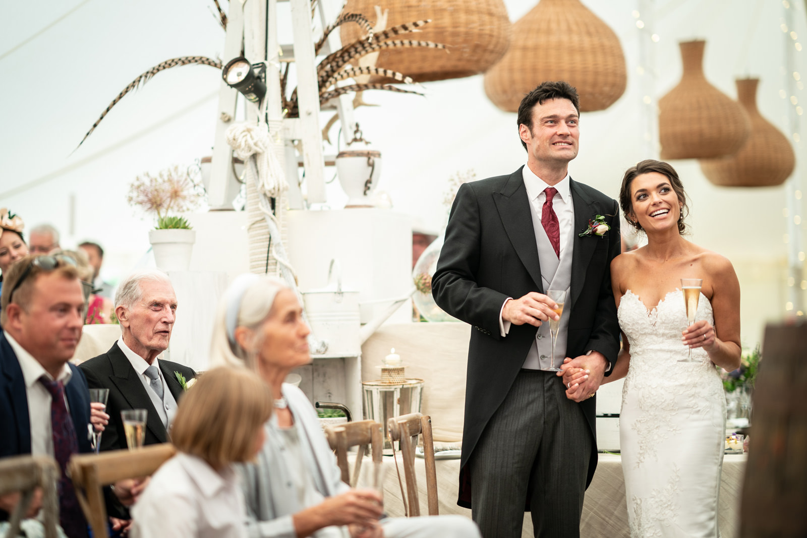 Couple listen to speeches in a Dorset Marquee