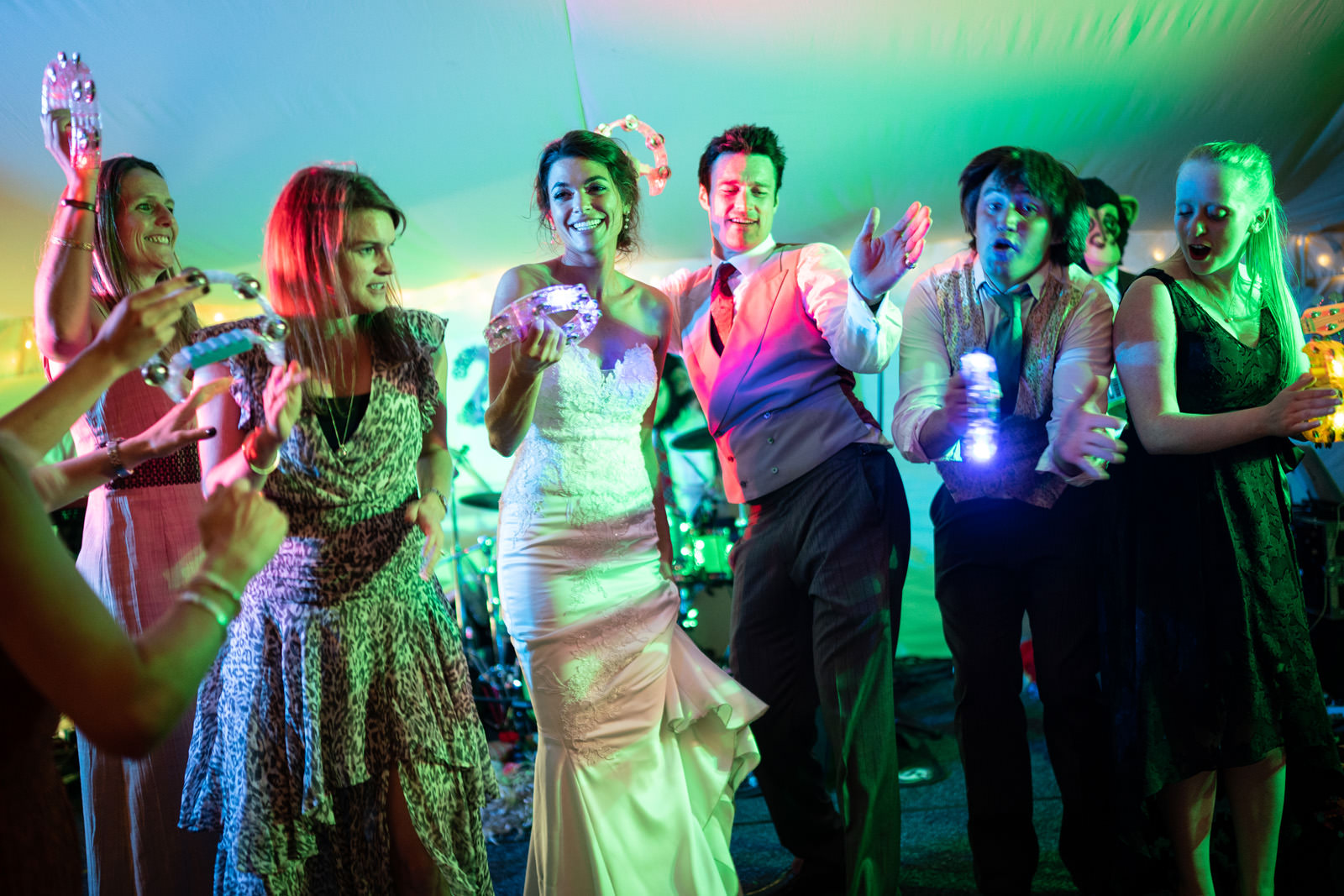 Newlyweds take over their marquee stage with tambourines