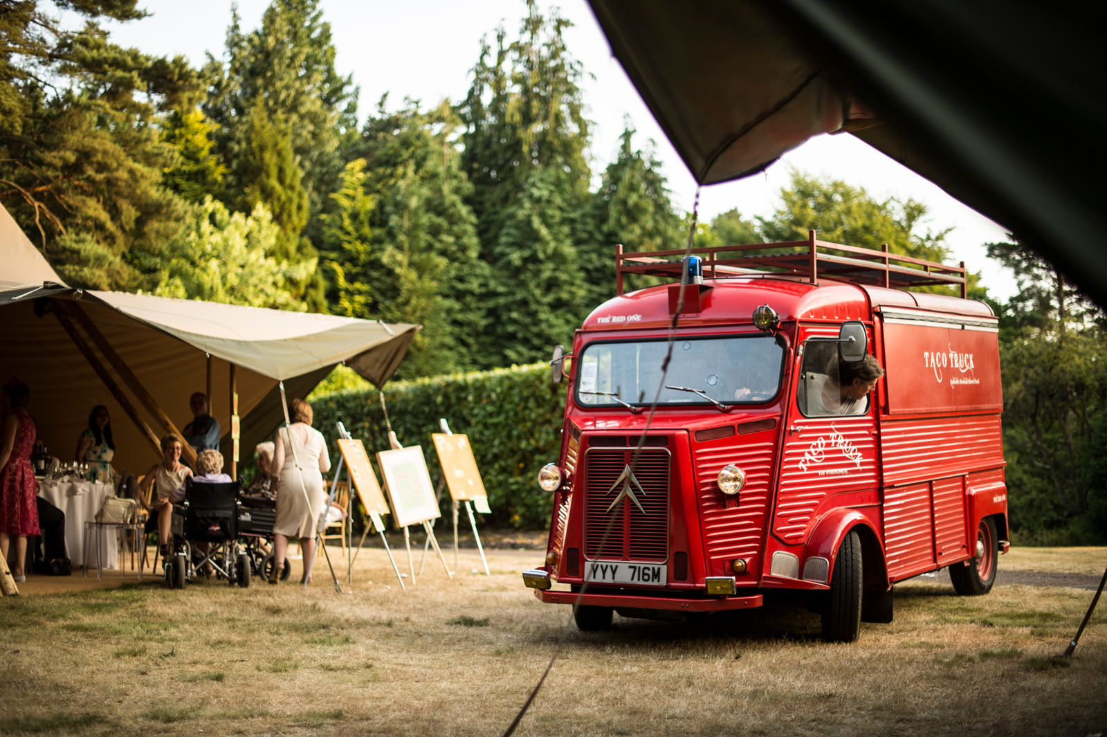 Red Taco Truck beside Wedding Marquee