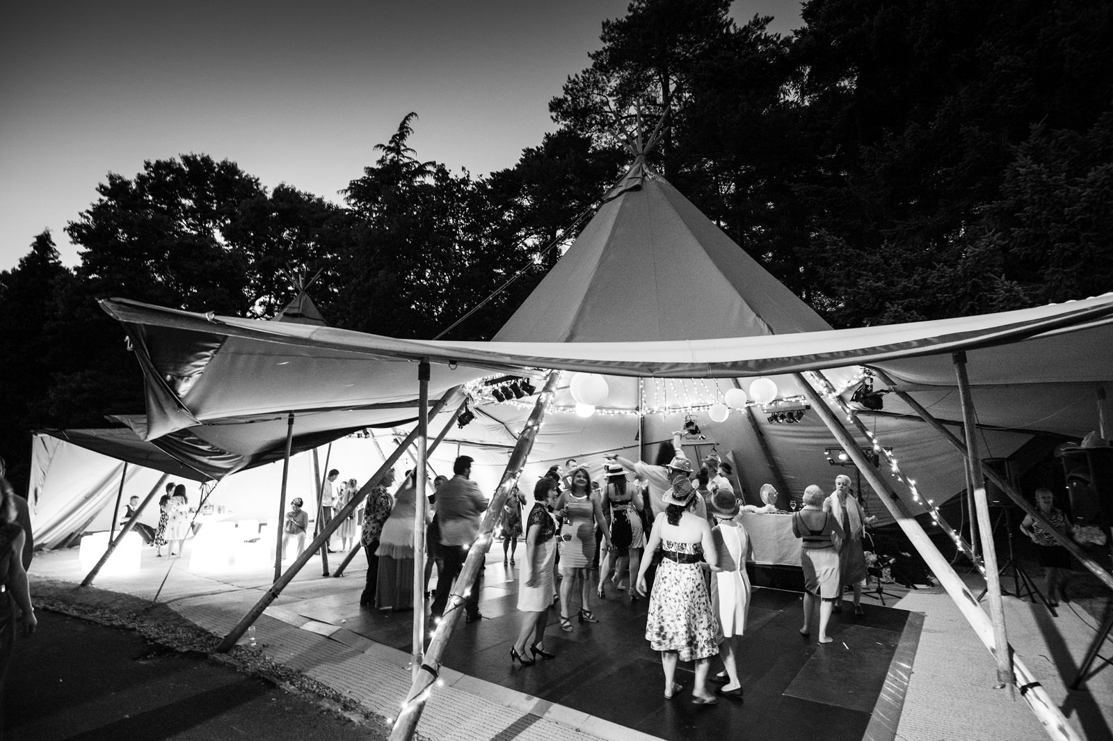 Guests dance in a Tipi Marquee