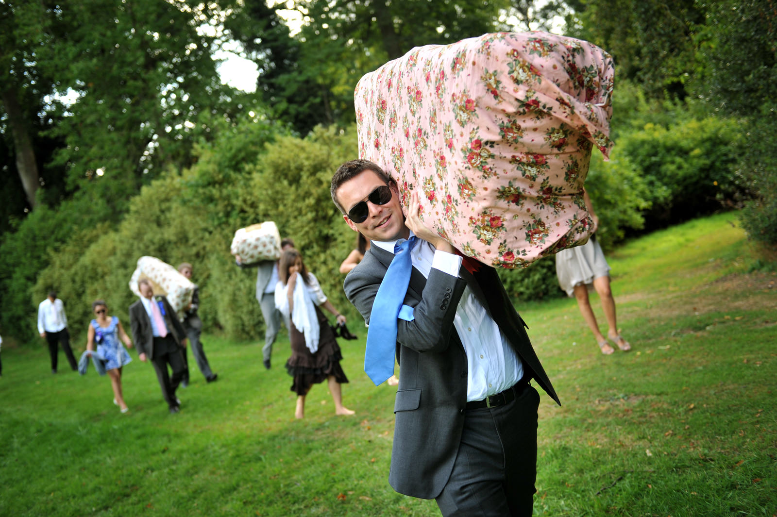 Wedding Guest carries Hay Bail for seating