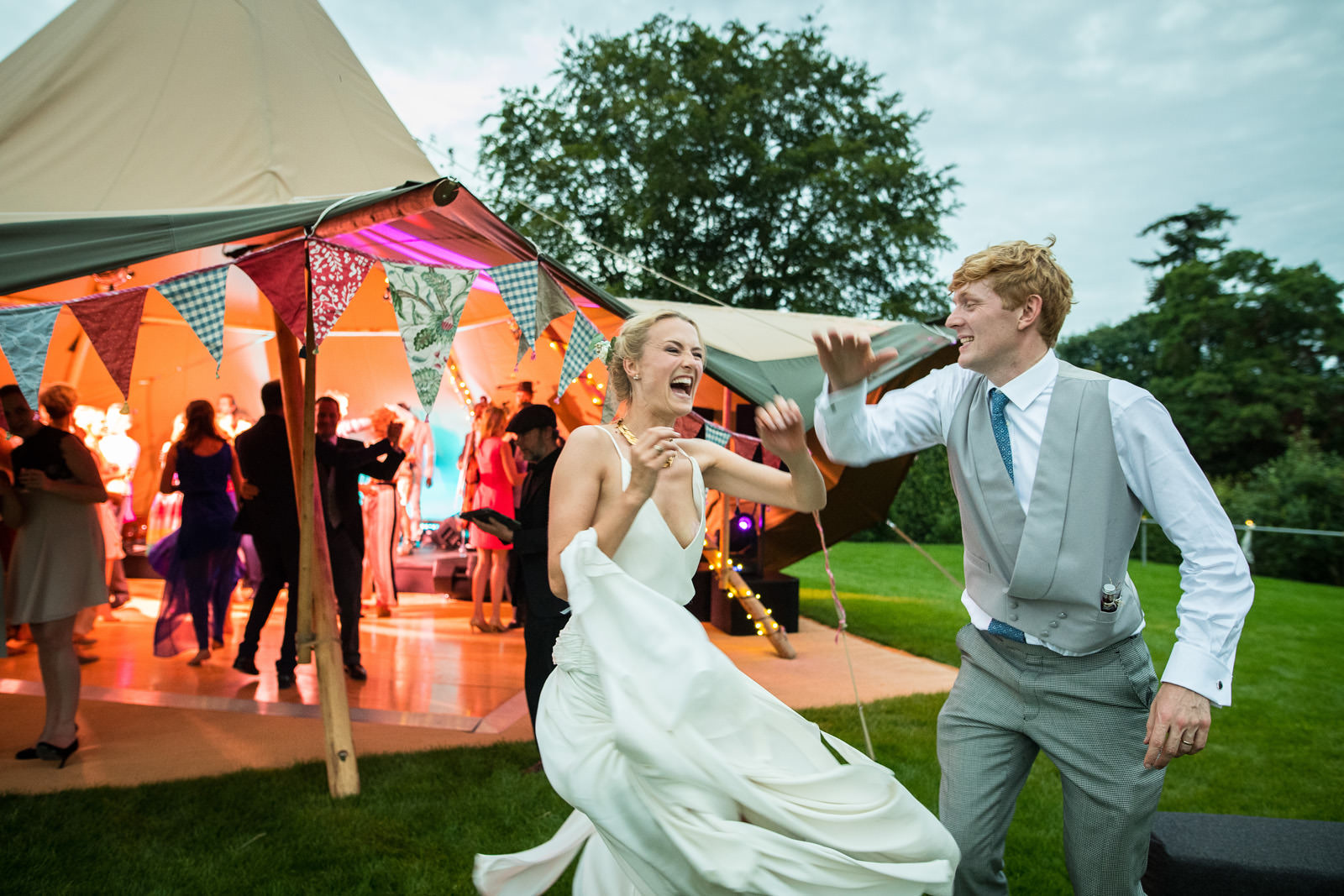 Bride and Groom dance outside their Marquee