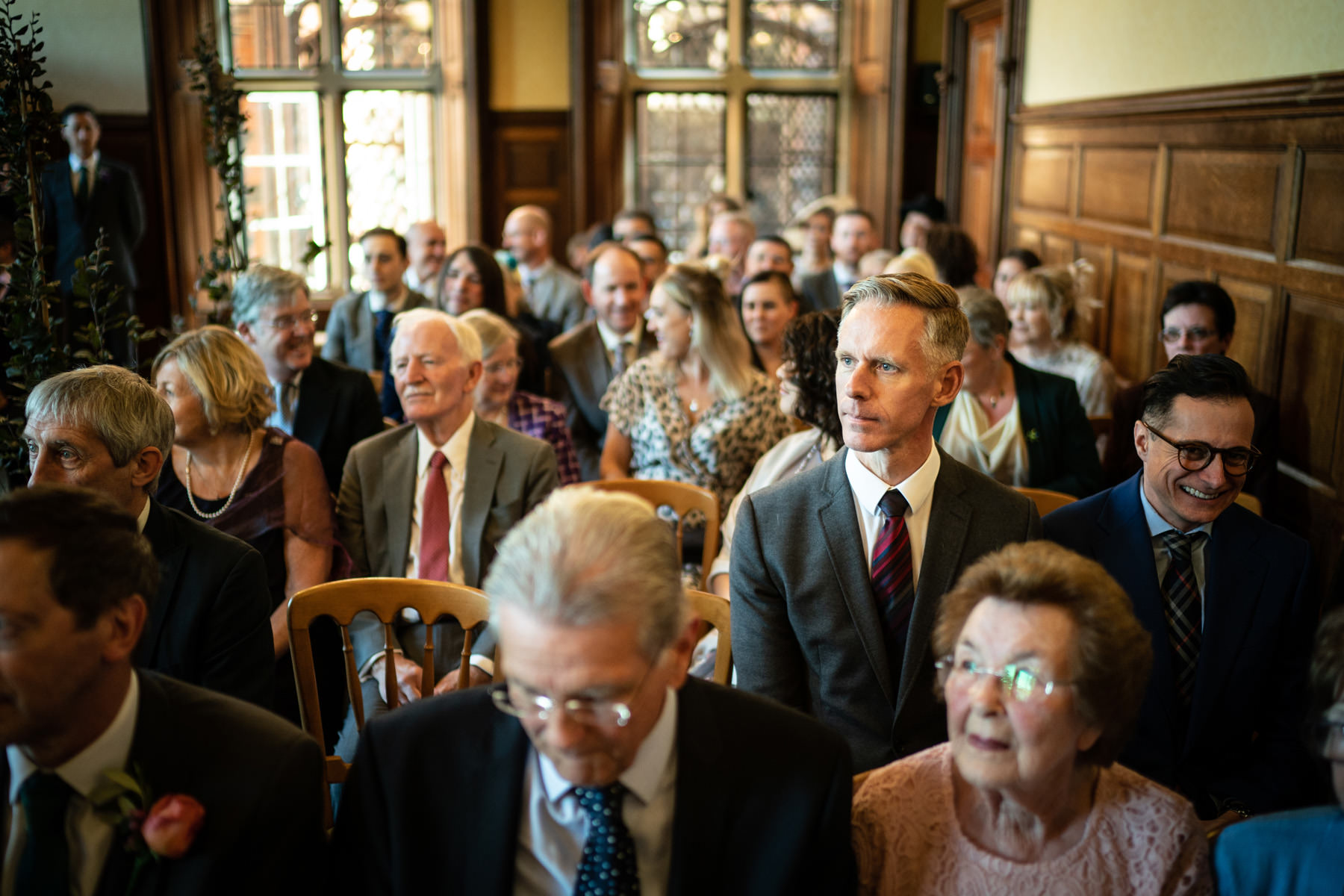 Wedding guests wait in The Oak room at The Elvetham Hotel