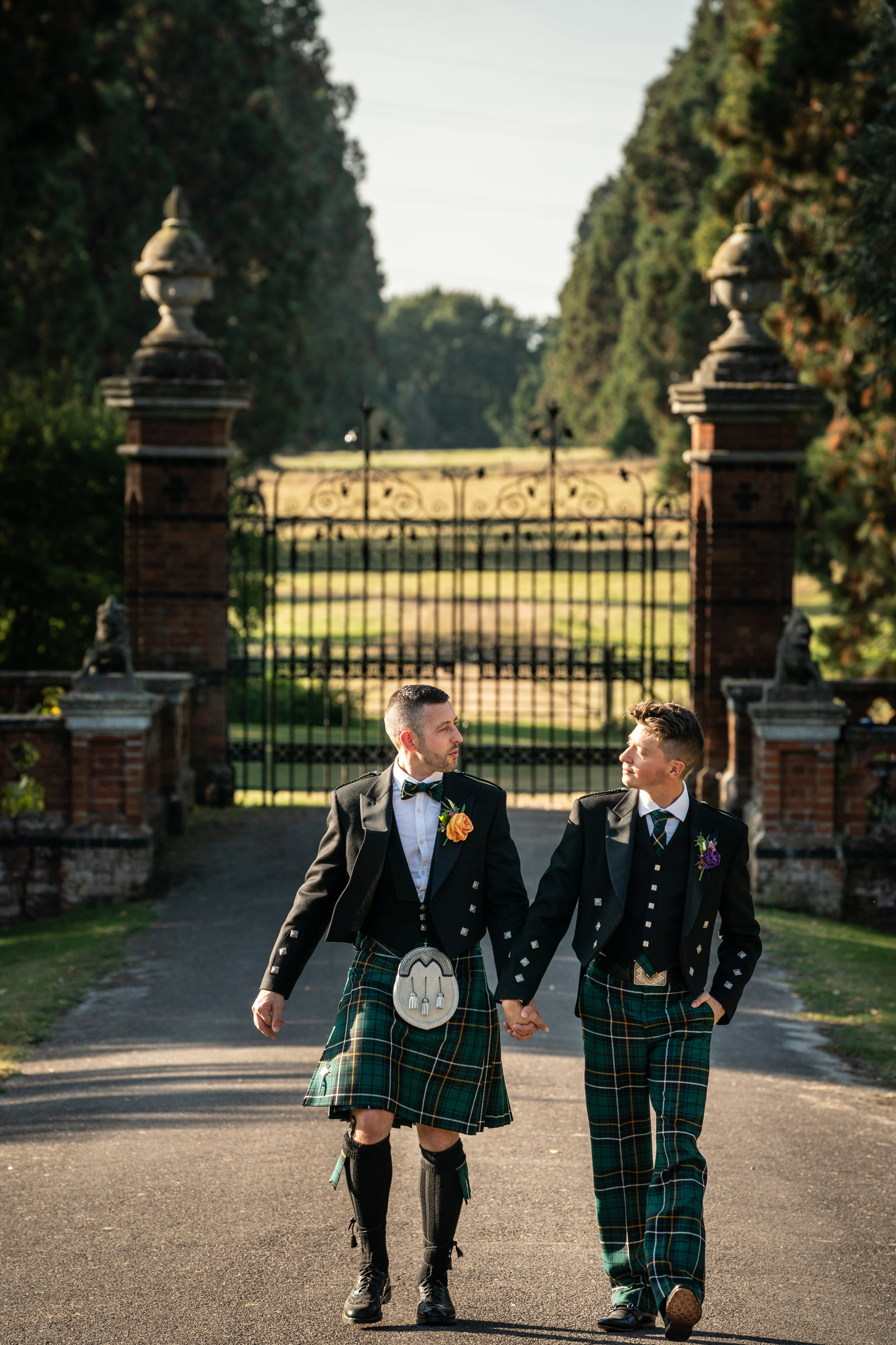 Newlyweds walk up the drive at The Elvetham Hotel