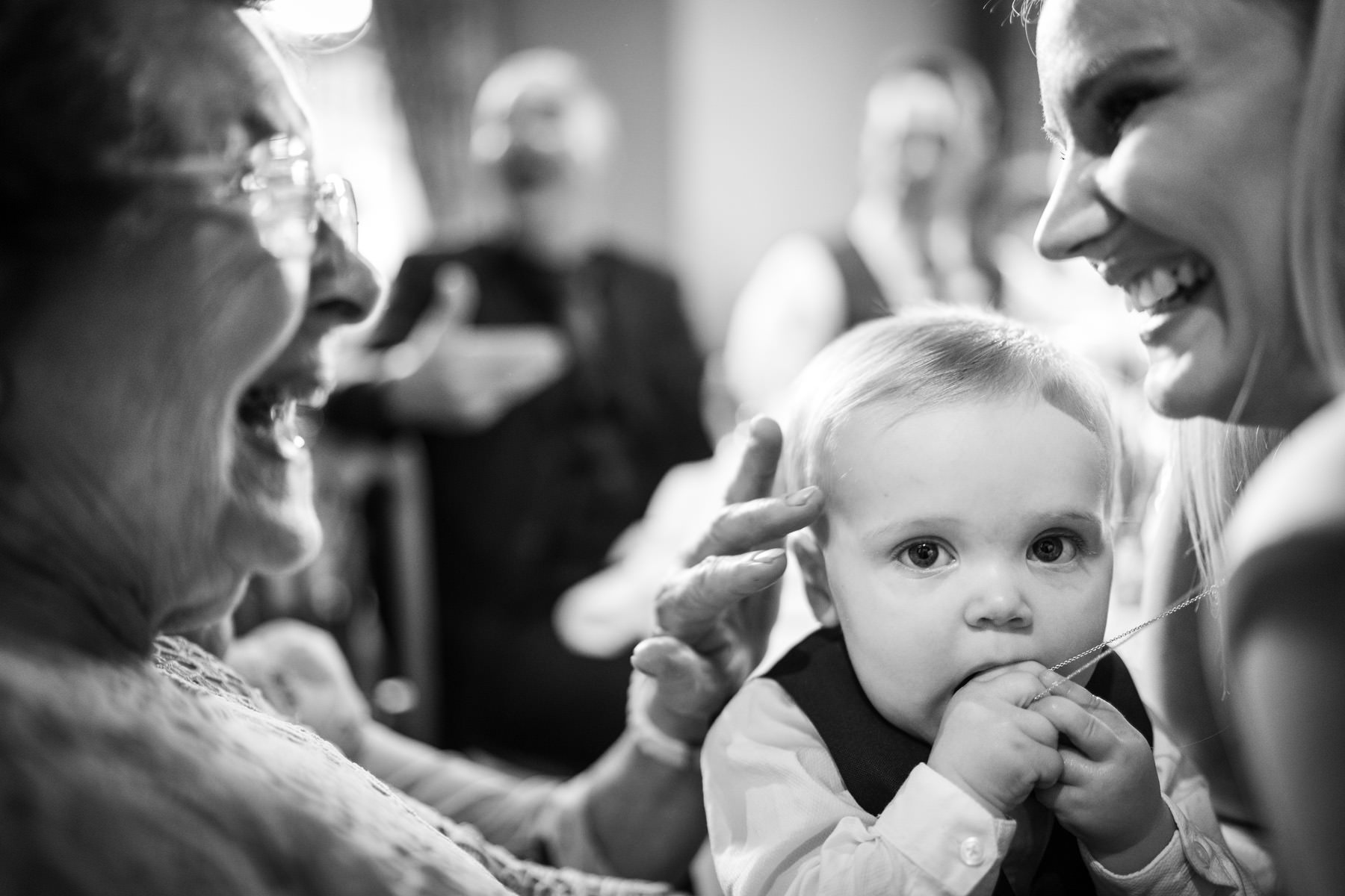 Granny with a baby at a gay wedding