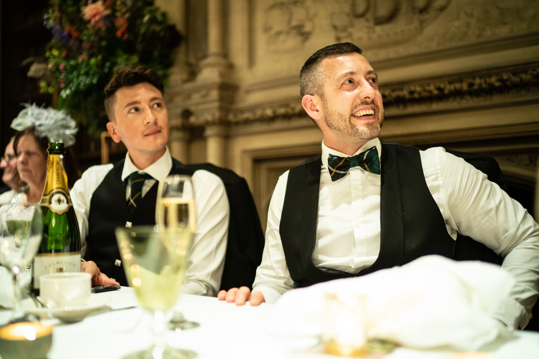 Groom looks at his new best man during the wedding speeches in the library at The Elvetham