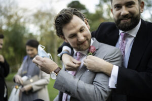 Groomsmen pinning button holes