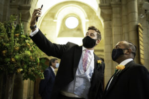 Best Man takes selfie with Groom in masks