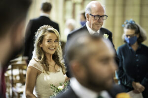 Bride arrives at St Benets Minister Catholic Church Beccles with her father