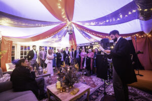 Best Man's Speech inside colourful marquee