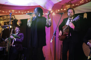 Wedding band play in colourful marquee