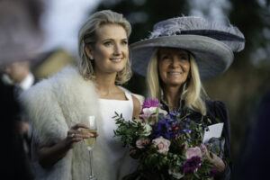 Bride and mother enjoy champagne at Oxfordshire Wedding