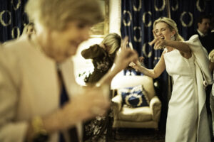 Bride laughs during Oxfordshire wedding