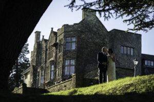 Newlyweds kiss in front of Pennyhill Hotel