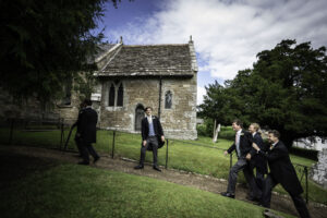 Groom is helped into Dorset church
