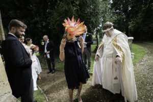 Bridesmaid puts on her mask before entering Dorset church
