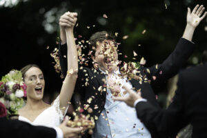 Groom gets a face full of confetti flowers